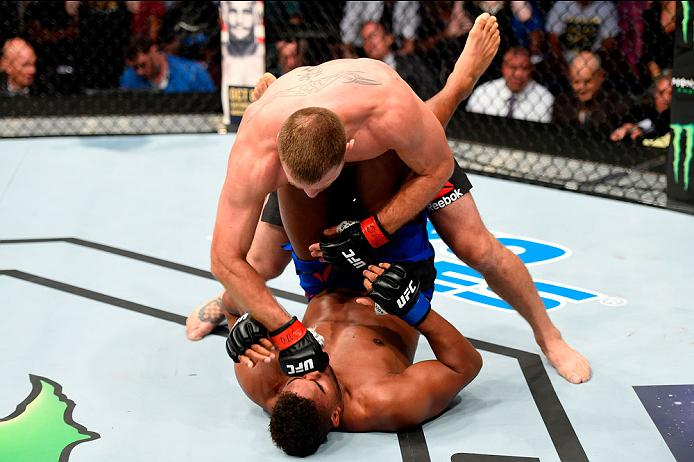 CLEVELAND, OH - SEPTEMBER 10:  Stipe Miocic (top) punches Alistair Overeem of The Netherlands in their UFC heavyweight championship bout during the UFC 203 event at Quicken Loans Arena on September 10, 2016 in Cleveland, Ohio. (Photo by Josh Hedges/Zuffa LLC/Zuffa LLC via Getty Images)