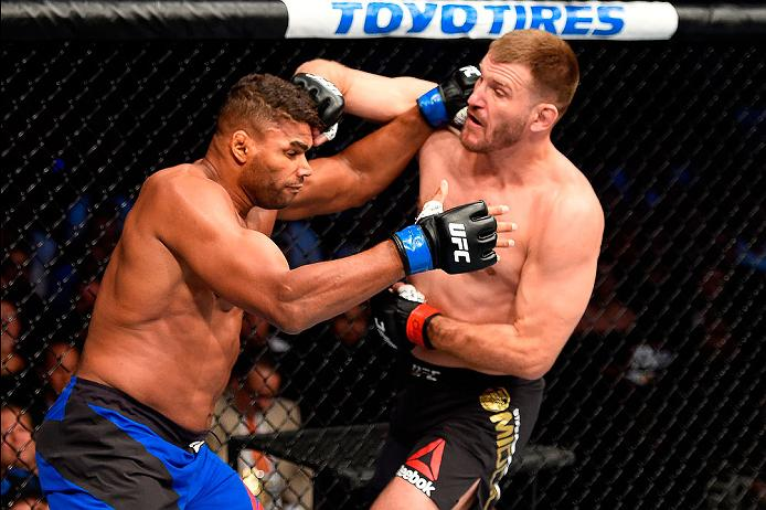 CLEVELAND, OH - SEPTEMBER 10:  (R-L) Stipe Miocic punches Alistair Overeem of The Netherlands in their UFC heavyweight championship bout during the UFC 203 event at Quicken Loans Arena on September 10, 2016 in Cleveland, Ohio. (Photo by Josh Hedges/Zuffa LLC/Zuffa LLC via Getty Images)