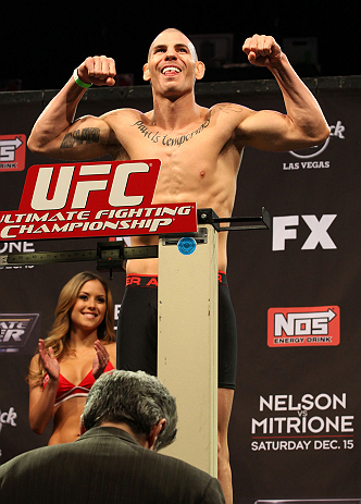 LAS VEGAS, NV - DECEMBER 14:  Jared Papazian on scale during TUF 16 Finale weigh in on December 14, 2012  at the Joint at the Hard Rock in Las Vegas, Nevada.  (Photo by Jim Kemper/Zuffa LLC/Zuffa LLC via Getty Images)