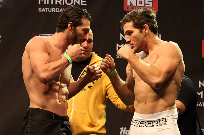 LAS VEGAS, NV - DECEMBER 14:  (L-R) Mike Rio and John Cofer face off during TUF 16 Finale weigh in on December 14, 2012  at the Joint at the Hard Rock in Las Vegas, Nevada.  (Photo by Jim Kemper/Zuffa LLC/Zuffa LLC via Getty Images)