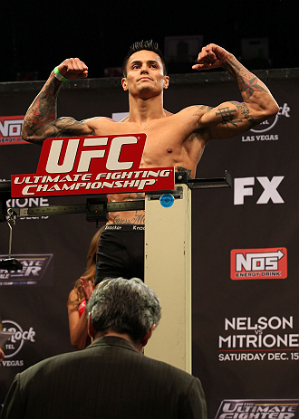 LAS VEGAS, NV - DECEMBER 14:  Reuben Duran steps onto the scale during TUF 16 Finale weigh in on December 14, 2012  at the Joint at the Hard Rock in Las Vegas, Nevada.  (Photo by Jim Kemper/Zuffa LLC/Zuffa LLC via Getty Images)