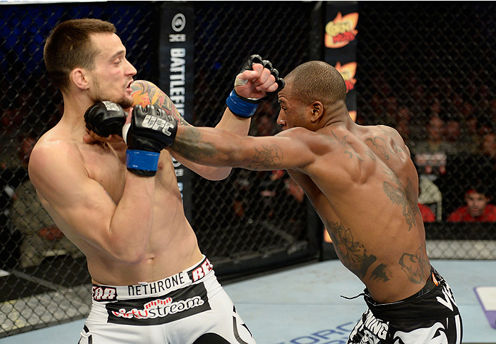 FORT CAMPBELL, KENTUCKY - NOVEMBER 6:  (R-L) Bobby Green punches James Krause in their UFC lightweight bout on November 6, 2013 in Fort Campbell, Kentucky. (Photo by Jeff Bottari/Zuffa LLC/Zuffa LLC via Getty Images) *** Local Caption ***Bobby Green; James Krause