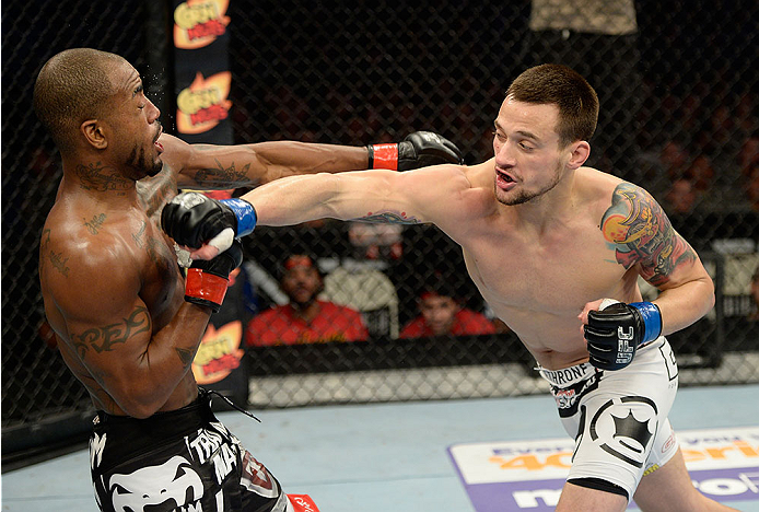 FORT CAMPBELL, KENTUCKY - NOVEMBER 6:  (R-L) James Krause punches Bobby Green in their UFC lightweight bout on November 6, 2013 in Fort Campbell, Kentucky. (Photo by Jeff Bottari/Zuffa LLC/Zuffa LLC via Getty Images) *** Local Caption ***Bobby Green; James Krause