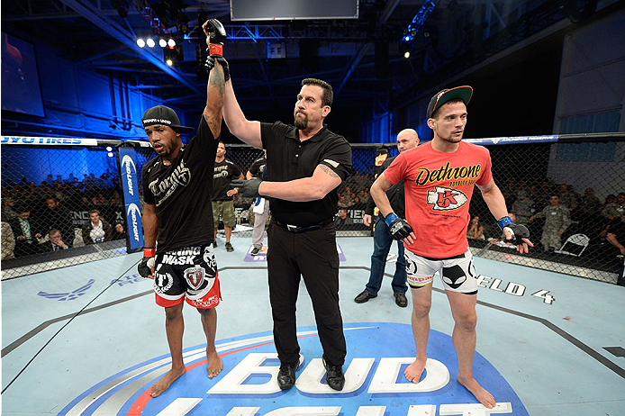 FORT CAMPBELL, KENTUCKY - NOVEMBER 6:  Bobby Green (left) is declared the winner against James Krause (right) in their UFC lightweight bout on November 6, 2013 in Fort Campbell, Kentucky. (Photo by Jeff Bottari/Zuffa LLC/Zuffa LLC via Getty Images) *** Local Caption ***Bobby Green; James Krause