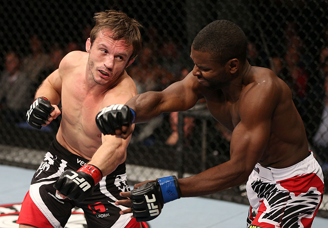 NOTTINGHAM, ENGLAND - SEPTEMBER 29:  (L-R) Brad Pickett punches Yves Jabouin during their bantamweight fight at the UFC on Fuel TV event at Capital FM Arena on September 29, 2012 in Nottingham, England.  (Photo by Josh Hedges/Zuffa LLC/Zuffa LLC via Getty Images)
