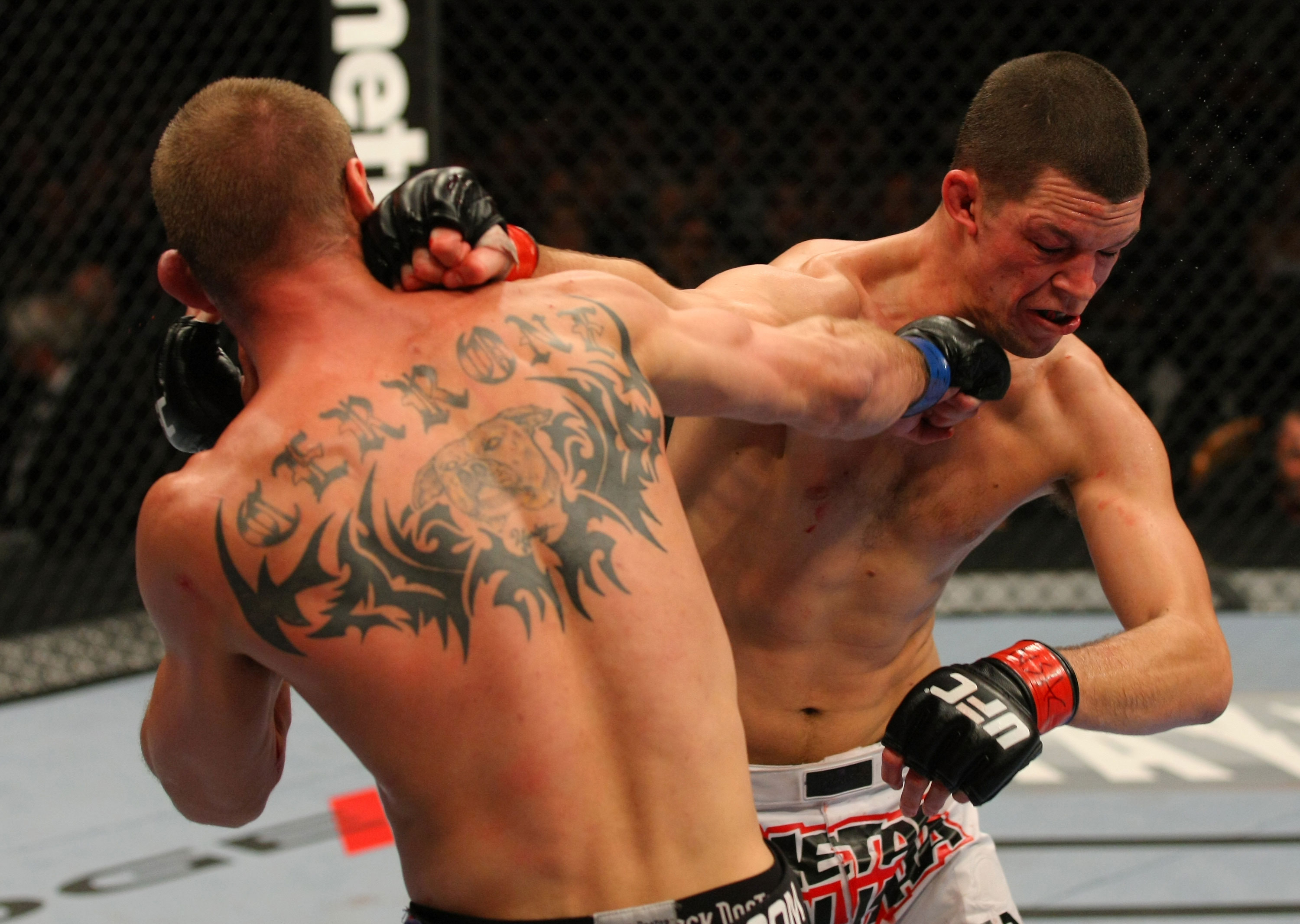 LAS VEGAS, NV - DECEMBER 30:  Donald Cerrone (left) and Nate Diaz (right) exchange blows during the UFC 141 event at the MGM Grand Garden Arena on December 30, 2011 in Las Vegas, Nevada.  (Photo by Donald Miralle/Zuffa LLC/Zuffa LLC via Getty Images) *** Local Caption *** Donald Cerrone; Nate Diaz