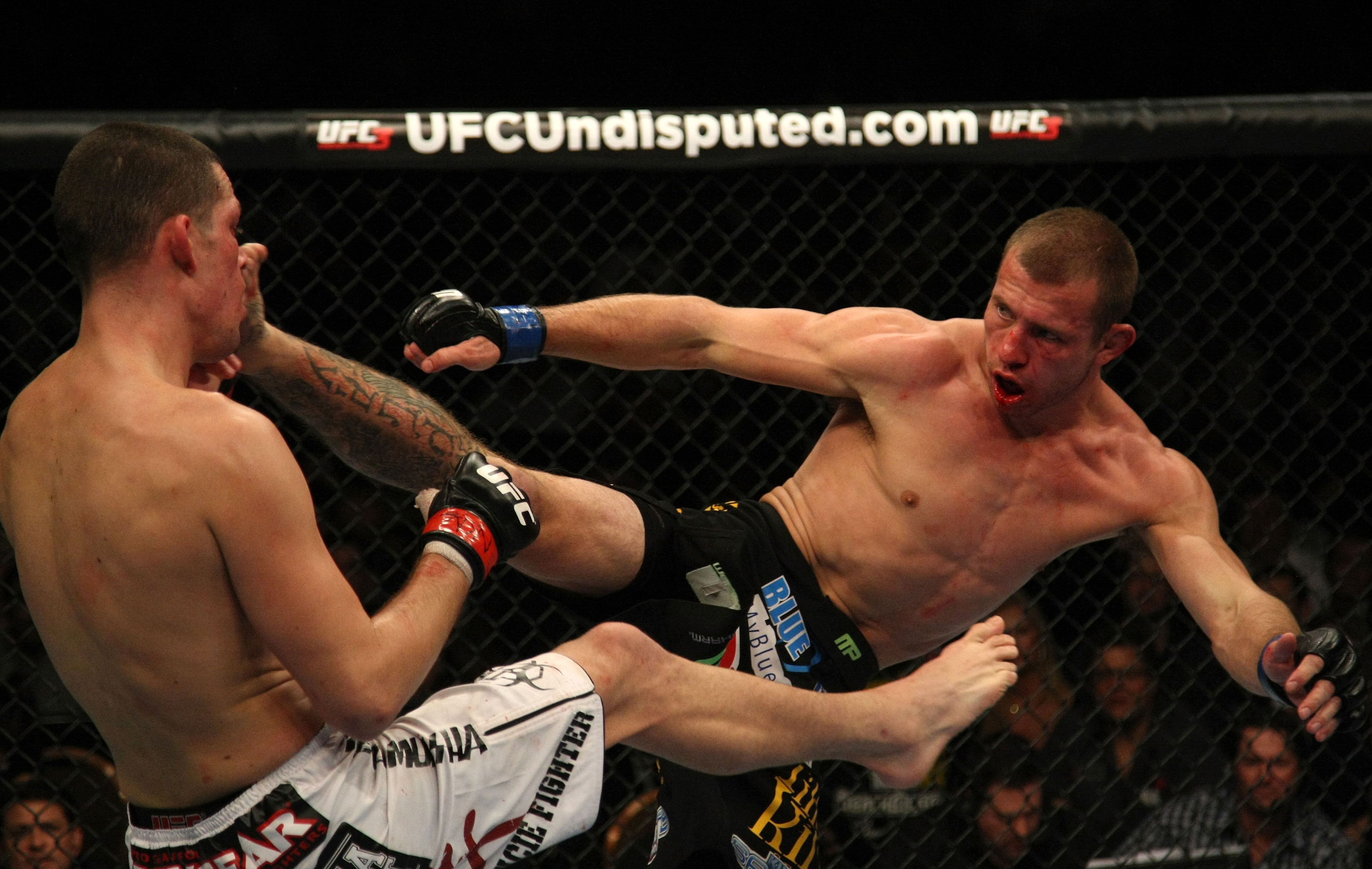 LAS VEGAS, NV - DECEMBER 30:  Donald Cerrone (right) kicks Nate Diaz during the UFC 141 event at the MGM Grand Garden Arena on December 30, 2011 in Las Vegas, Nevada.  (Photo by Donald Miralle/Zuffa LLC/Zuffa LLC via Getty Images) *** Local Caption *** Donald Cerrone; Nate Diaz