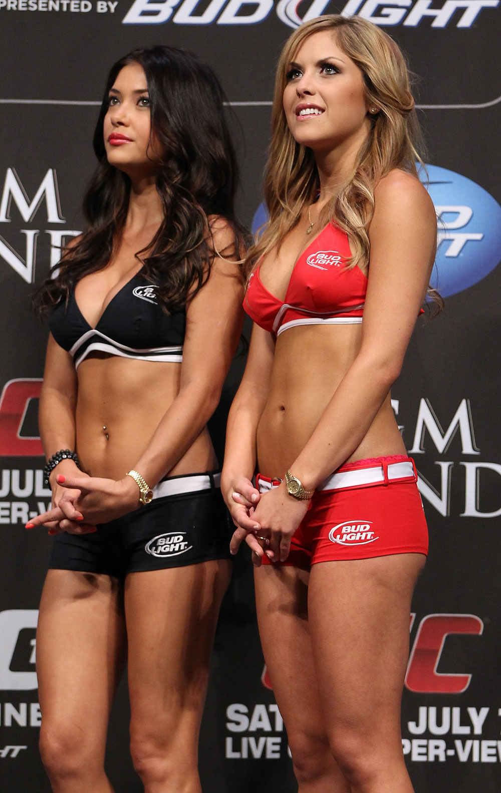 LAS VEGAS, NV - JULY 6:   (R-L) UFC Octagon Girls Brittney Palmer and Arianny Celeste stand on stage during the UFC 148 Weigh In at the Mandalay Bay Events Center on July 6, 2012 in Las Vegas, Nevada.  (Photo by Josh Hedges/Zuffa LLC/Zuffa LLC via Getty Images)