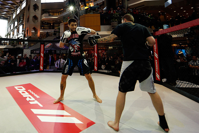 MONTREAL, QC - MARCH 13:  Carlos Condit (L) conducts an open training session for fans and media ahead of his UFC 158 bout at Complexe Desjardins on March 13, 2013 in Montreal, Quebec, Canada.  (Photo by Josh Hedges/Zuffa LLC/Zuffa LLC via Getty Images)