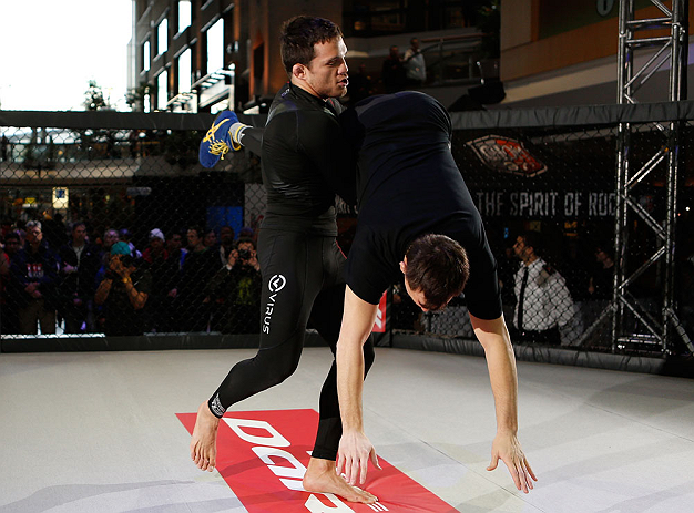 MONTREAL, QC - MARCH 13:  Jake Ellenberger (L) conducts an open training session for fans and media ahead of his UFC 158 bout at Complexe Desjardins on March 13, 2013 in Montreal, Quebec, Canada.  (Photo by Josh Hedges/Zuffa LLC/Zuffa LLC via Getty Images)
