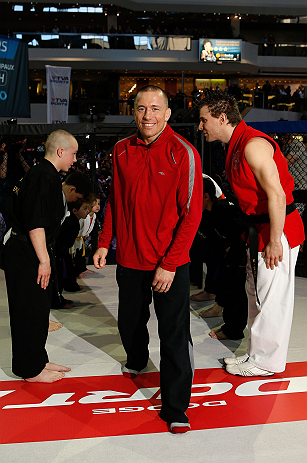 MONTREAL, QC - MARCH 13:  UFC welterweight champion Georges St-Pierre is greeted by local students from the Sunfuki Karate school as he enters the Octaogn during the UFC 158 open workouts at Complexe Desjardins on March 13, 2013 in Montreal, Quebec, Canada.  (Photo by Josh Hedges/Zuffa LLC/Zuffa LLC via Getty Images)