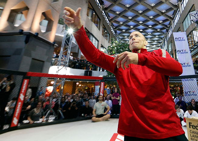 MONTREAL, QC - MARCH 13:  UFC welterweight champion Georges St-Pierre tosses autographed DVD's into the crowd during the UFC 158 open workouts at Complexe Desjardins on March 13, 2013 in Montreal, Quebec, Canada.  (Photo by Josh Hedges/Zuffa LLC/Zuffa LLC via Getty Images)