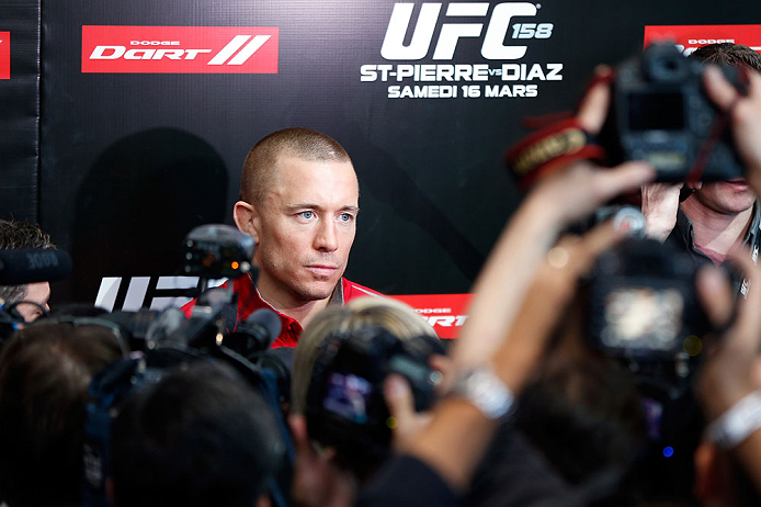 MONTREAL, QC - MARCH 13:  UFC welterweight champion Georges St-Pierre interacts with media during the UFC 158 open workouts at Complexe Desjardins on March 13, 2013 in Montreal, Quebec, Canada.  (Photo by Josh Hedges/Zuffa LLC/Zuffa LLC via Getty Images)