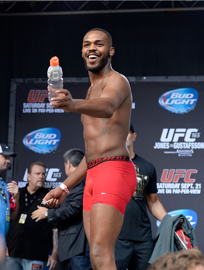TORONTO, CANADA - SEPTEMBER 20:  UFC light heavyweight champion Jon 'Bones' Jones signs his Gatorade bottle for the crowd of fans during the UFC 165 weigh-in at the Maple Leaf Square on September 20, 2013 in Toronto, Ontario, Canada. (Photo by Jeff Bottari/Zuffa LLC/Zuffa LLC via Getty Images)