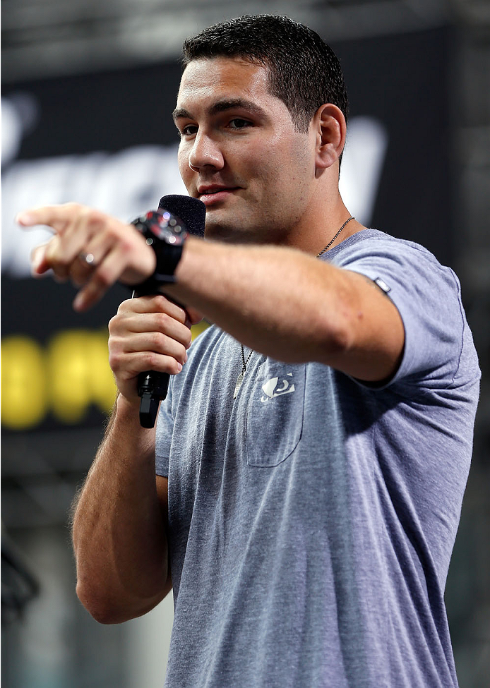 TORONTO, CANADA - SEPTEMBER 20:  UFC Middleweight Champion Chris Weidman interacts with fans during a Q&A session before the UFC 165 weigh-in event at Maple Leaf Square outside the Air Canada Centre on September 20, 2013 in Toronto, Ontario, Canada. (Photo by Josh Hedges/Zuffa LLC/Zuffa LLC via Getty Images)