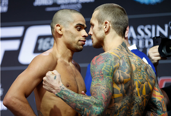 TORONTO, CANADA - SEPTEMBER 20:  (L-R) Opponents Renan Barao and Eddie Wineland face off during the UFC 165 weigh-in event at Maple Leaf Square outside the Air Canada Centre on September 20, 2013 in Toronto, Ontario, Canada. (Photo by Josh Hedges/Zuffa LLC/Zuffa LLC via Getty Images)