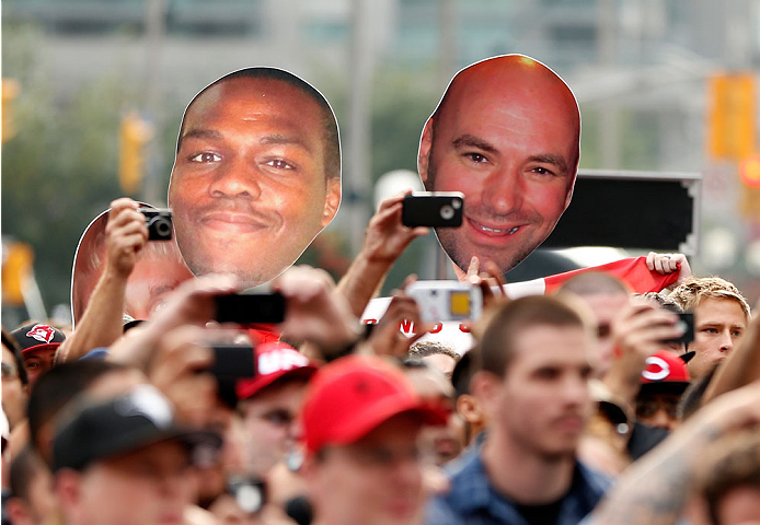 "TORONTO, CANADA - SEPTEMBER 20:  A fan displays signs of Jon ""Bones"" Jones and UFC President Dana White during the UFC 165 weigh-in event at Maple Leaf Square outside the Air Canada Centre on September 20, 2013 in Toronto, Ontario, Canada. (Photo by Josh Hedges/Zuffa LLC/Zuffa LLC via Getty Images)"