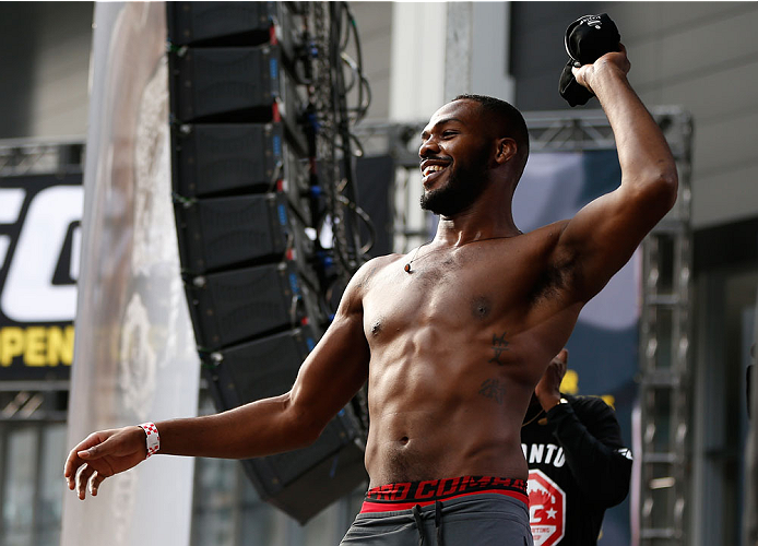 "TORONTO, CANADA - SEPTEMBER 20:  Jon ""Bones"" Jones throws his Nike shirt into the crowd before stepping on the scale during the UFC 165 weigh-in event at Maple Leaf Square outside the Air Canada Centre on September 20, 2013 in Toronto, Ontario, Canada. (Photo by Josh Hedges/Zuffa LLC/Zuffa LLC via Getty Images)"