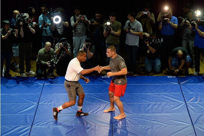 HOUSTON, TX - OCTOBER 16:  UFC Heavyweight Champion Cain Velasquez (R) and Daniel Cormier (L) hold an open training session inside House of Blues on October 16, 2013 in Houston, Texas. (Photo by Jeff Bottari/Zuffa LLC/Zuffa LLC via Getty Images) *** Local Caption *** Cain Velasquez; Daniel Cormier