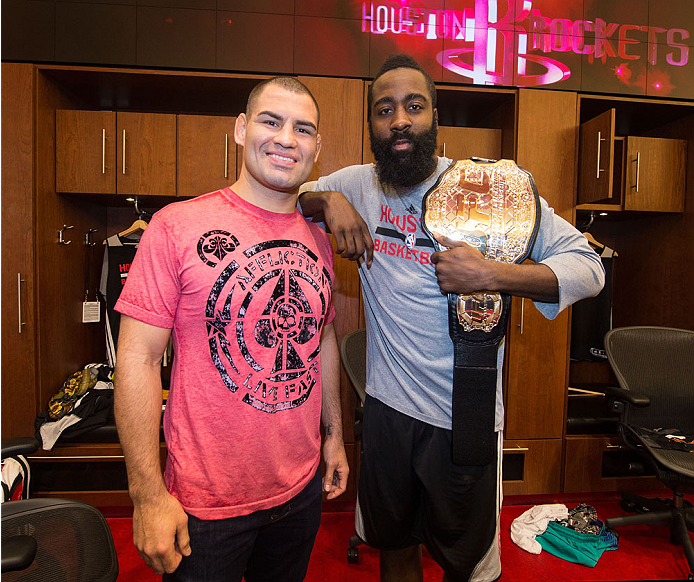 HOUSTON, TX - OCTOBER 16:  (L-R) UFC Heavyweight Champion Cain Velasquez and NBA Houston Rockets player James Harden pose in the Houston Rockets locker room during the UFC 166 Ultimate Media Day at the Toyota Center on October 16, 2013 in Houston, Texas. (Photo by Jeff Bottari/Zuffa LLC/Zuffa LLC via Getty Images) *** Local Caption *** Cain Velasquez; James Harden