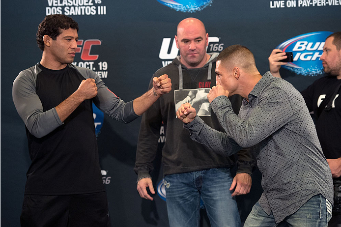 HOUSTON, TX - OCTOBER 16:  Gilbert Melendez (L) and Diego Sanchez (R) face off in front of UFC President Dana White (C) for the media during the UFC 166 Ultimate Media Day at the Toyota Center on October 16, 2013 in Houston, Texas. (Photo by Jeff Bottari/Zuffa LLC/Zuffa LLC via Getty Images) *** Local Caption *** Gilbert Melendez; Diego Sanchez; Dana White
