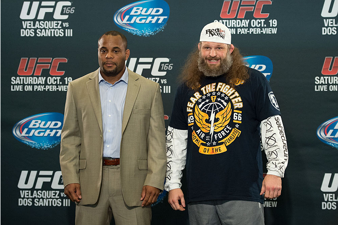 HOUSTON, TX - OCTOBER 16:  Daniel Cormier (L) and Roy 'Big Country' Nelson (R) pose for the media during the UFC 166 Ultimate Media Day at the Toyota Center on October 16, 2013 in Houston, Texas. (Photo by Jeff Bottari/Zuffa LLC/Zuffa LLC via Getty Images) *** Local Caption *** Daniel Cormier; Roy Nelson
