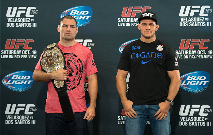 HOUSTON, TX - OCTOBER 16:  UFC Heavyweight Champion Cain Velasquez (L) and Junior Dos Santos (R) pose for the media during the UFC 166 Ultimate Media Day at the Toyota Center on October 16, 2013 in Houston, Texas. (Photo by Jeff Bottari/Zuffa LLC/Zuffa LLC via Getty Images) *** Local Caption *** Cain Velasquez; Junior Dos Santos
