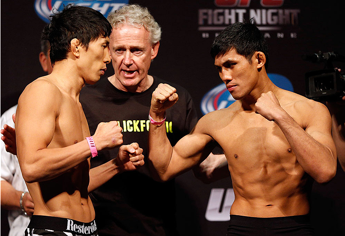 BRISBANE, AUSTRALIA - DECEMBER 06:  (L-R) Opponents Takeya Mizugaki and Nam Phan face off during the UFC Fight Night weigh-in at the Brisbane Entertainment Centre on December 6, 2013 in Brisbane, Australia. (Photo by Josh Hedges/Zuffa LLC/Zuffa LLC via Getty Images)