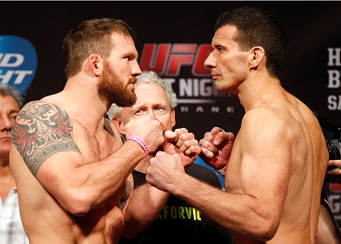 BRISBANE, AUSTRALIA - DECEMBER 06:  (L-R) Opponents Ryan Bader and Anthony Perosh face off during the UFC Fight Night weigh-in at the Brisbane Entertainment Centre on December 6, 2013 in Brisbane, Australia. (Photo by Josh Hedges/Zuffa LLC/Zuffa LLC via Getty Images)