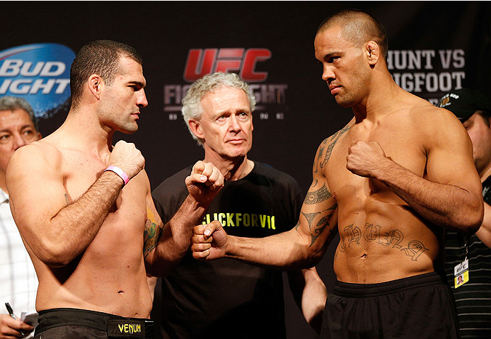 "BRISBANE, AUSTRALIA - DECEMBER 06:  (L-R) Opponents Mauricio ""Shogun"" Rua and James Te Huna face off during the UFC Fight Night weigh-in at the Brisbane Entertainment Centre on December 6, 2013 in Brisbane, Australia. (Photo by Josh Hedges/Zuffa LLC/Zuffa LLC via Getty Images)"
