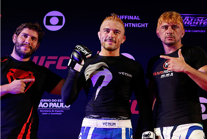 "SAO PAULO, BRAZIL - MAY 29:  Rony ""Jason"" Mariano-Bazzera (center) poses for photos after an open training session for media at the Renaissance Hotel on May 29, 2014 in Sao Paulo, Brazil. (Photo by Josh Hedges/Zuffa LLC/Zuffa LLC via Getty Images)"