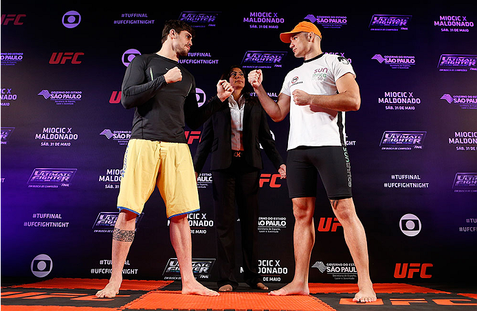 SAO PAULO, BRAZIL - MAY 29:  (L-R) Opponents Antonio Carlos Junior and Vitor Miranda face off before an open training session for media at the Renaissance Hotel on May 29, 2014 in Sao Paulo, Brazil. (Photo by Josh Hedges/Zuffa LLC/Zuffa LLC via Getty Images)