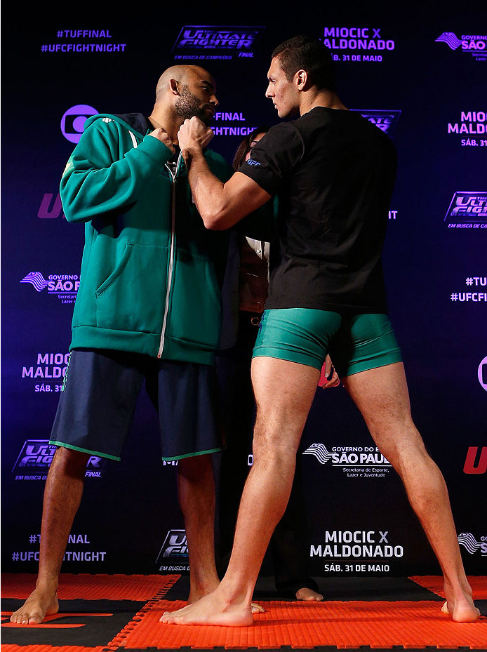 SAO PAULO, BRAZIL - MAY 29:  (L-R) Opponents Warlley Alves and Marcio Alexandre face off before an open training session for media at the Renaissance Hotel on May 29, 2014 in Sao Paulo, Brazil. (Photo by Josh Hedges/Zuffa LLC/Zuffa LLC via Getty Images)