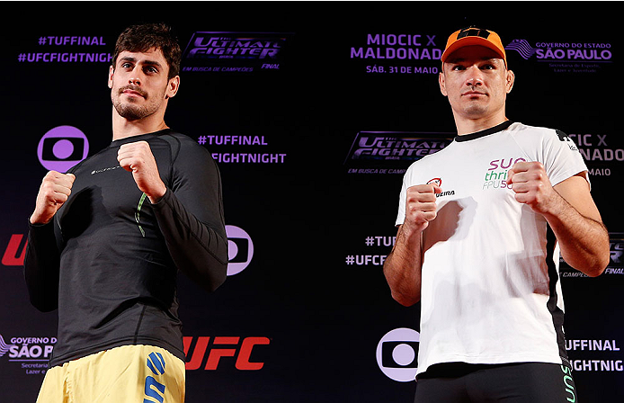 SAO PAULO, BRAZIL - MAY 29:  (L-R) Opponents Antonio Carlos Junior and Vitor Miranda pose for photos before an open training session for media at the Renaissance Hotel on May 29, 2014 in Sao Paulo, Brazil. (Photo by Josh Hedges/Zuffa LLC/Zuffa LLC via Getty Images)