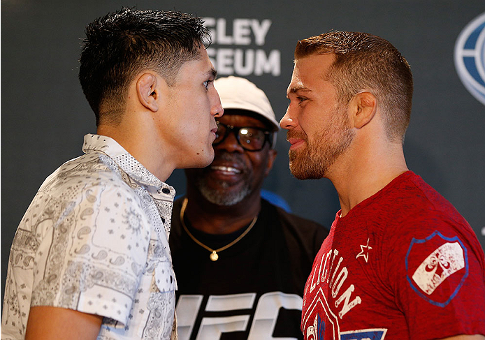ALBUQUERQUE, NM - JUNE 05:  (L-R) Opponents Erik Perez and Bryan Caraway face off during the UFC Ultimate Media day at EXPO New Mexico on June 5, 2014 in Albuquerque, New Mexico. (Photo by Josh Hedges/Zuffa LLC/Zuffa LLC via Getty Images)