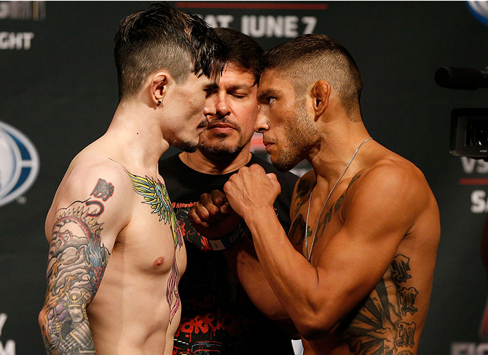 ALBUQUERQUE, NM - JUNE 06:  (L-R) Opponents Scott Jorgensen and Danny Martinez face off during the UFC Fight Night weigh-in at Tingley Coliseum on June 6, 2014 in Albuquerque, New Mexico.  (Photo by Josh Hedges/Zuffa LLC/Zuffa LLC via Getty Images)