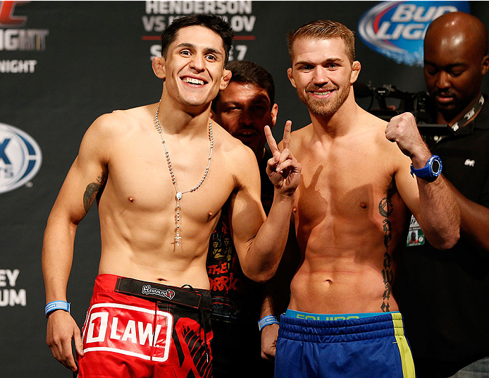ALBUQUERQUE, NM - JUNE 06:  (L-R) Opponents Erik Perez and Bryan Caraway pose for photos during the UFC Fight Night weigh-in at Tingley Coliseum on June 6, 2014 in Albuquerque, New Mexico.  (Photo by Josh Hedges/Zuffa LLC/Zuffa LLC via Getty Images)