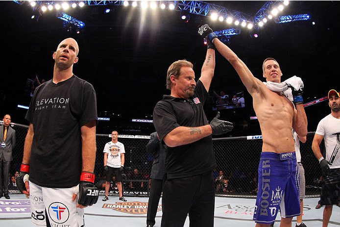MILWAUKEE, WI - AUGUST 31:  Magnus Cedenblad (blue shorts) celebrates after being declared the winner over Jared Hamman (white shorts) in their UFC middleweight bout at BMO Harris Bradley Center on August 31, 2013 in Milwaukee, Wisconsin. (Photo by Ed Mulholland/Zuffa LLC/Zuffa LLC via Getty Images) *** Local Caption *** Jared Hamman; Magnus Cedenblad