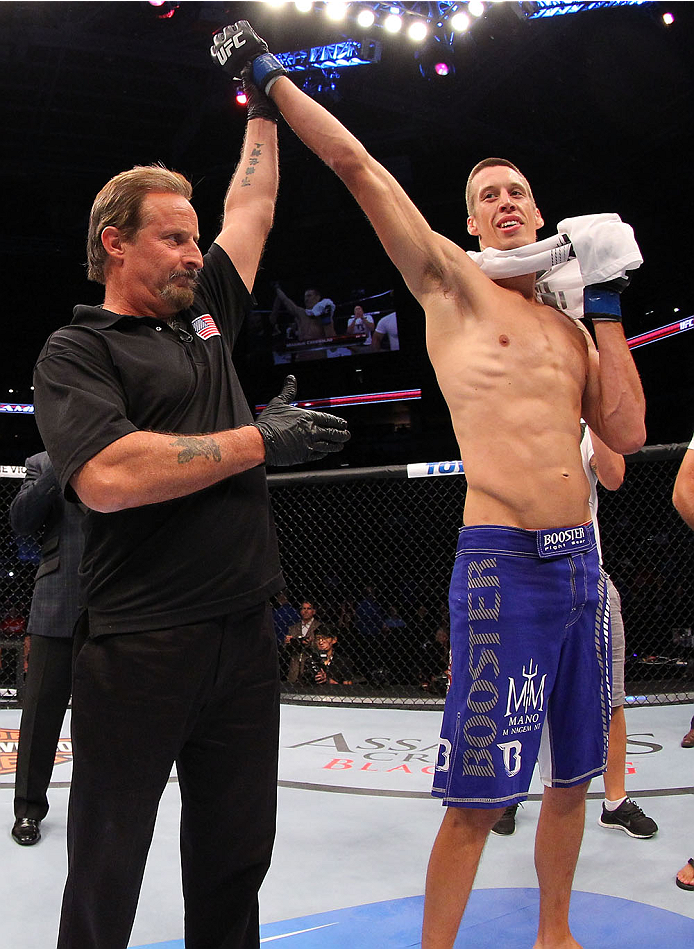 MILWAUKEE, WI - AUGUST 31:  Magnus Cedenblad celebrates after being declared the winner over Jared Hamman (not pictured) in their UFC middleweight bout at BMO Harris Bradley Center on August 31, 2013 in Milwaukee, Wisconsin. (Photo by Ed Mulholland/Zuffa LLC/Zuffa LLC via Getty Images) *** Local Caption ***  Magnus Cedenblad