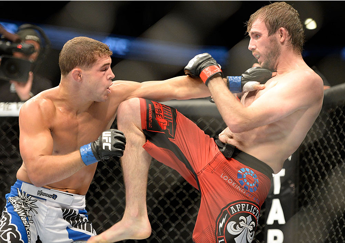 MILWAUKEE, WI - AUGUST 31:  (L-R) Al Iaquinta punches Ryan Couture in their UFC lightweight bout at BMO Harris Bradley Center on August 31, 2013 in Milwaukee, Wisconsin. (Photo by Jeff Bottari/Zuffa LLC/Zuffa LLC via Getty Images) *** Local Caption *** Ryan Couture; Al Iaquinta