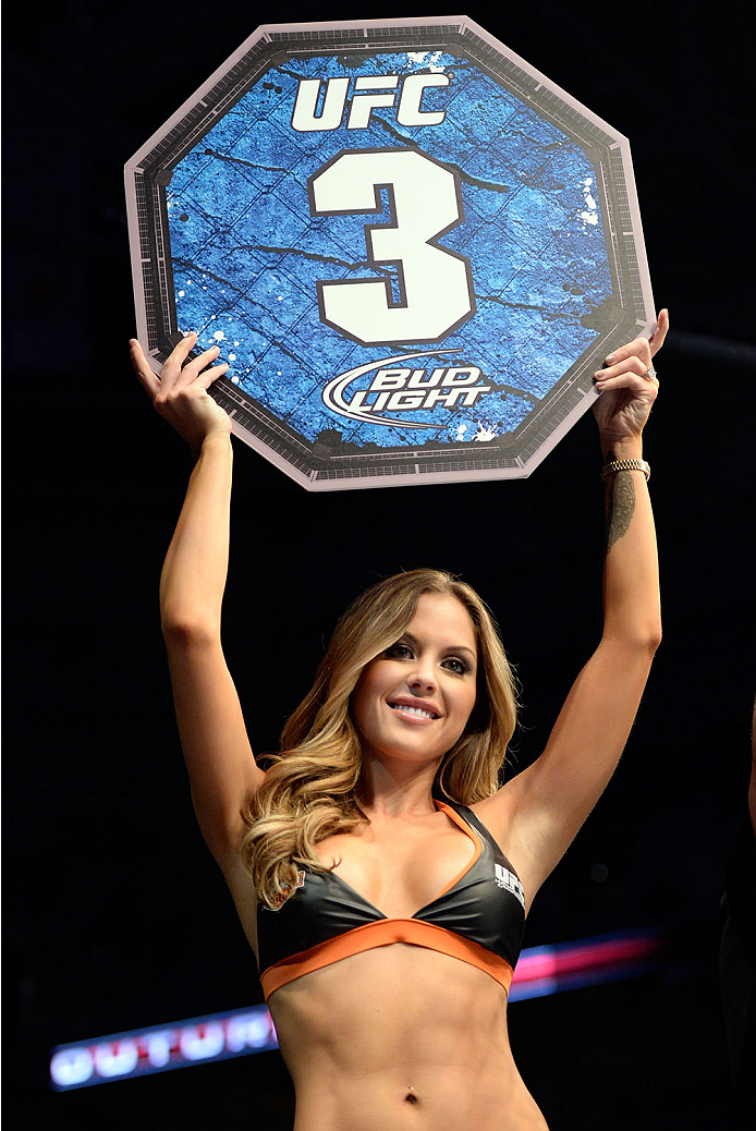 MILWAUKEE, WI - AUGUST 31:  UFC Octagon Girl Brittney Palmer introduces round three between Ryan Couture and Al Iaquinta in their UFC lightweight bout at BMO Harris Bradley Center on August 31, 2013 in Milwaukee, Wisconsin. (Photo by Jeff Bottari/Zuffa LLC/Zuffa LLC via Getty Images) *** Local Caption *** Brittney Palmer