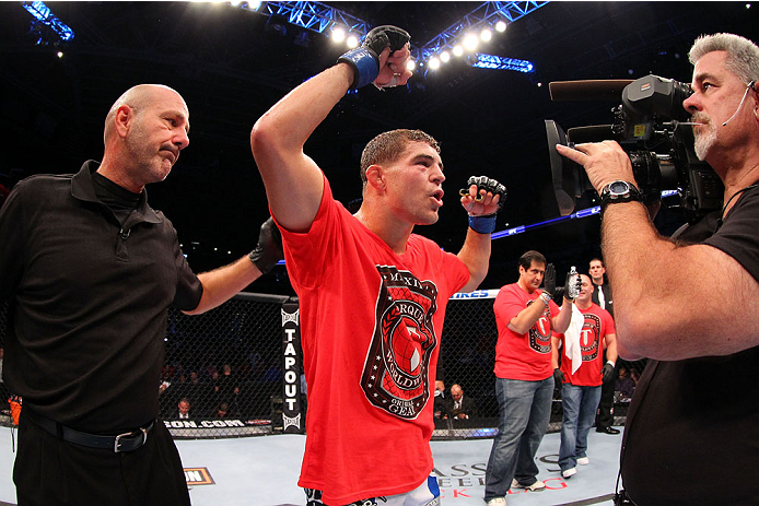 MILWAUKEE, WI - AUGUST 31:  Al Iaquinta celebrates after defeating Ryan Couture (not pictured) in their UFC lightweight bout at BMO Harris Bradley Center on August 31, 2013 in Milwaukee, Wisconsin. (Photo by Ed Mulholland/Zuffa LLC/Zuffa LLC via Getty Images) *** Local Caption ***  Al Iaquinta