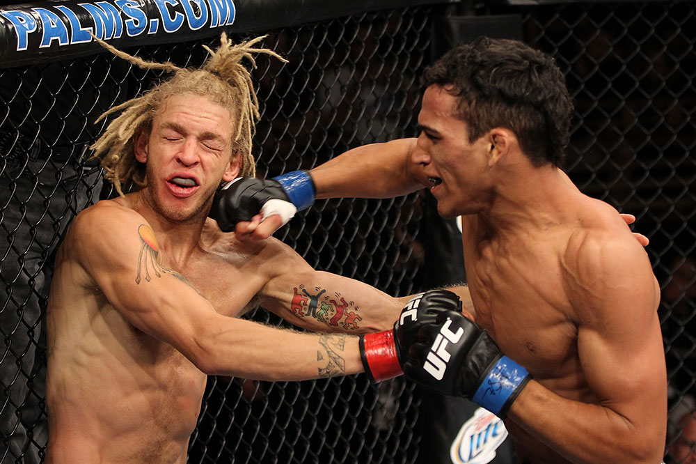 LAS VEGAS, NV - JUNE 01:   (R-L) Charles Oliveira punches Jonathan Brookins in a Featherweight bout during The Ultimate Fighter Live Finale at the Pearl Theater at the Palms Casino Resort on June 1, 2012 in Las Vegas, Nevada.  (Photo by Josh Hedges/Zuffa LLC/Zuffa LLC via Getty Images)  *** Local Caption *** Jonathan Brookins; Charles Oliveira