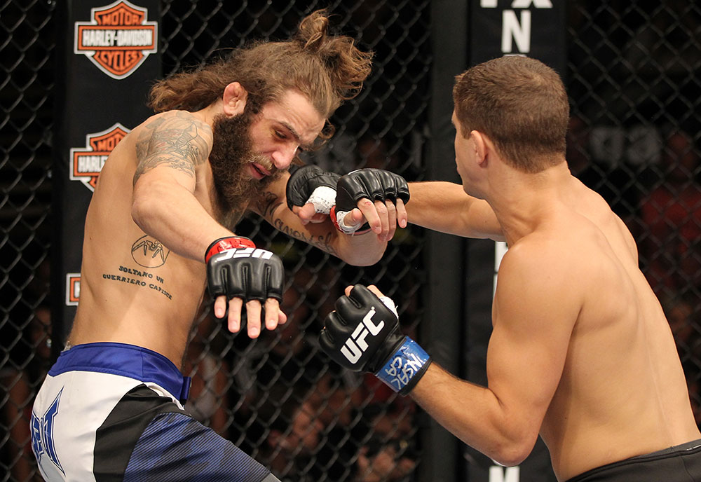 LAS VEGAS, NV - JUNE 01:   (R-L) Al Iaquinta punches Michael Chiesa in a Lightweight bout during The Ultimate Fighter Live Finale at the Pearl Theater at the Palms Casino Resort on June 1, 2012 in Las Vegas, Nevada.  (Photo by Josh Hedges/Zuffa LLC/Zuffa LLC via Getty Images)  *** Local Caption *** Al Iaquinta; Michael Chiesa