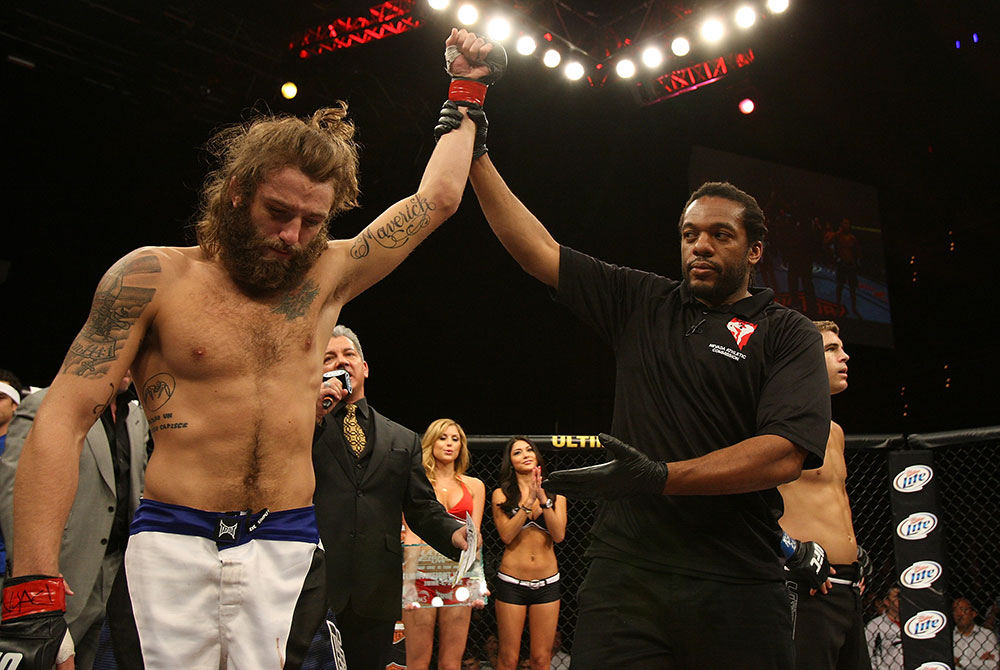 LAS VEGAS, NV - JUNE 01:   Michael Chiesa (left) reacts to being declared the winner over Al Iaquinta (right) during The Ultimate Fighter Live Finale at the Pearl Theater at the Palms Casino Resort on June 1, 2012 in Las Vegas, Nevada.  (Photo by Josh Hedges/Zuffa LLC/Zuffa LLC via Getty Images)  *** Local Caption *** Al Iaquinta; Michael Chiesa
