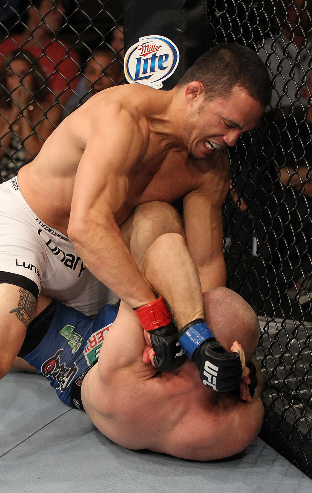 LAS VEGAS, NV - JUNE 01:   Jake Ellenberger (top) punches Martin Kampmann in a Welterweight bout during The Ultimate Fighter Live Finale at the Pearl Theater at the Palms Casino Resort on June 1, 2012 in Las Vegas, Nevada.  (Photo by Josh Hedges/Zuffa LLC/Zuffa LLC via Getty Images)  *** Local Caption *** Jake Ellenberger; Martin Kampmann