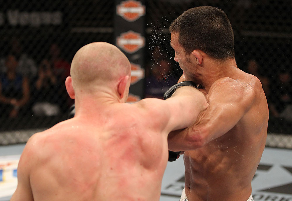 LAS VEGAS, NV - JUNE 01:   (L-R) Martin Kampmann punches Jake Ellenberger in a Welterweight bout during The Ultimate Fighter Live Finale at the Pearl Theater at the Palms Casino Resort on June 1, 2012 in Las Vegas, Nevada.  (Photo by Josh Hedges/Zuffa LLC/Zuffa LLC via Getty Images)  *** Local Caption *** Jake Ellenberger; Martin Kampmann