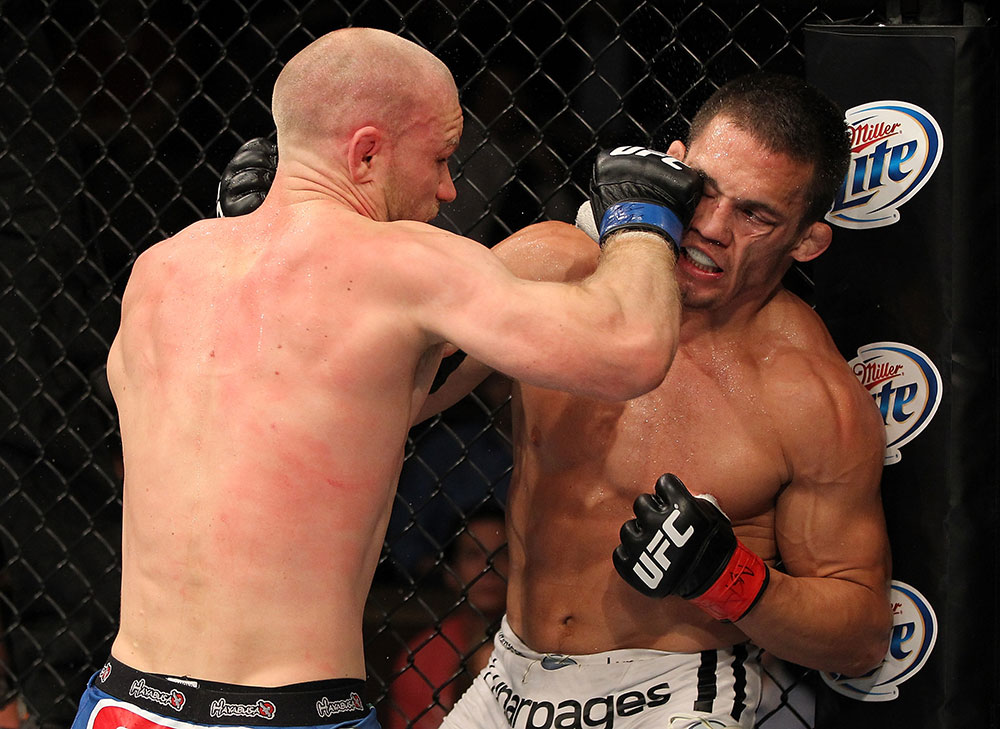 LAS VEGAS, NV - JUNE 01:   Martin Kampmann (left) punches Jake Ellenberger in a Welterweight bout during The Ultimate Fighter Live Finale at the Pearl Theater at the Palms Casino Resort on June 1, 2012 in Las Vegas, Nevada.  (Photo by Josh Hedges/Zuffa LLC/Zuffa LLC via Getty Images)  *** Local Caption *** Jake Ellenberger; Martin Kampmann