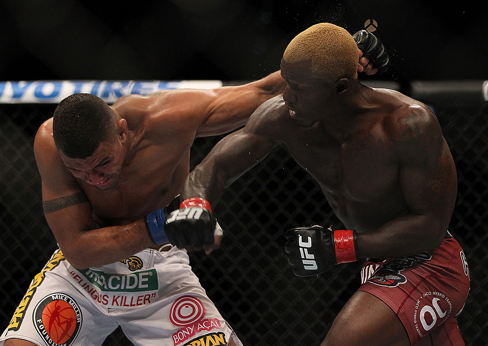 LAS VEGAS, NV - JULY 7:   Mevlin Guillard (right) punches Fabricio Camoes during their lightweight bout at UFC 148 inside MGM Grand Garden Arena on July 7, 2012 in Las Vegas, Nevada.  (Photo by Josh Hedges/Zuffa LLC/Zuffa LLC via Getty Images)  *** Local Caption *** Melvin Guillard; Fabricio Camoes