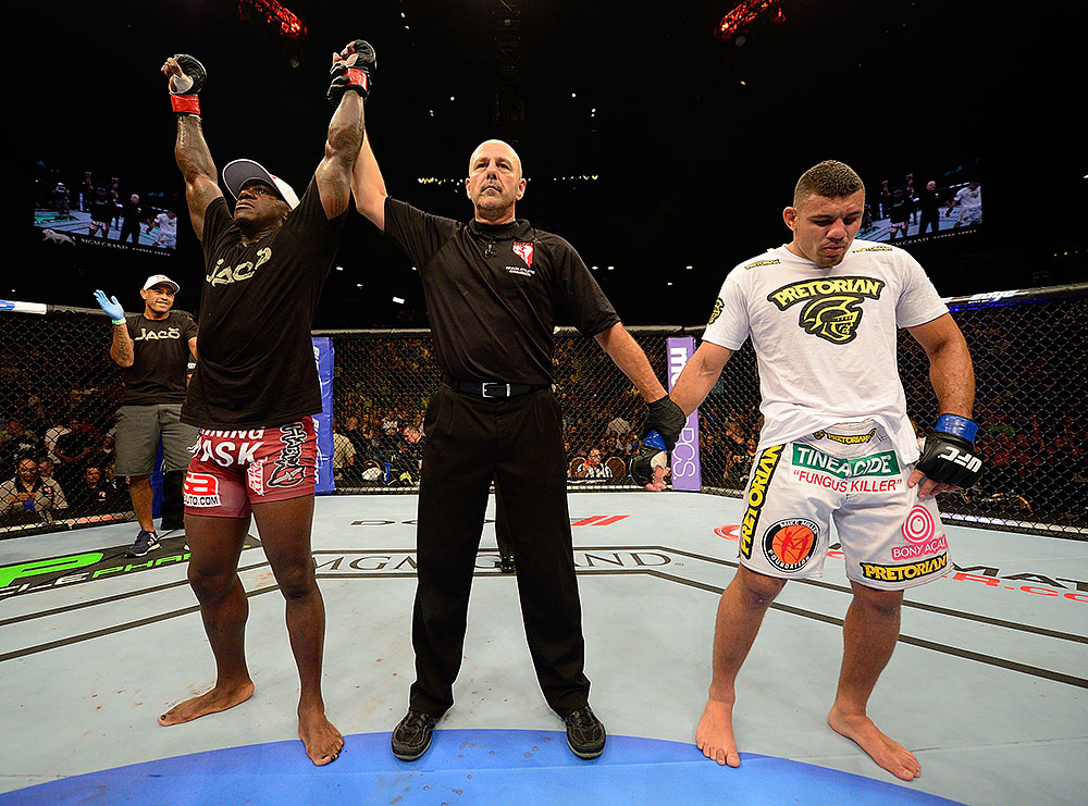 LAS VEGAS, NV - JULY 7:   Melvin Guillard (left) is declared the winner in his fight against Fabricio Camoes (right) during UFC 148 inside MGM Grand Garden Arena on July 7, 2012 in Las Vegas, Nevada.  (Photo by Donald Miralle/Zuffa LLC/Zuffa LLC via Getty Images)  *** Local Caption *** Melvin Guillard; Fabricio Camoes